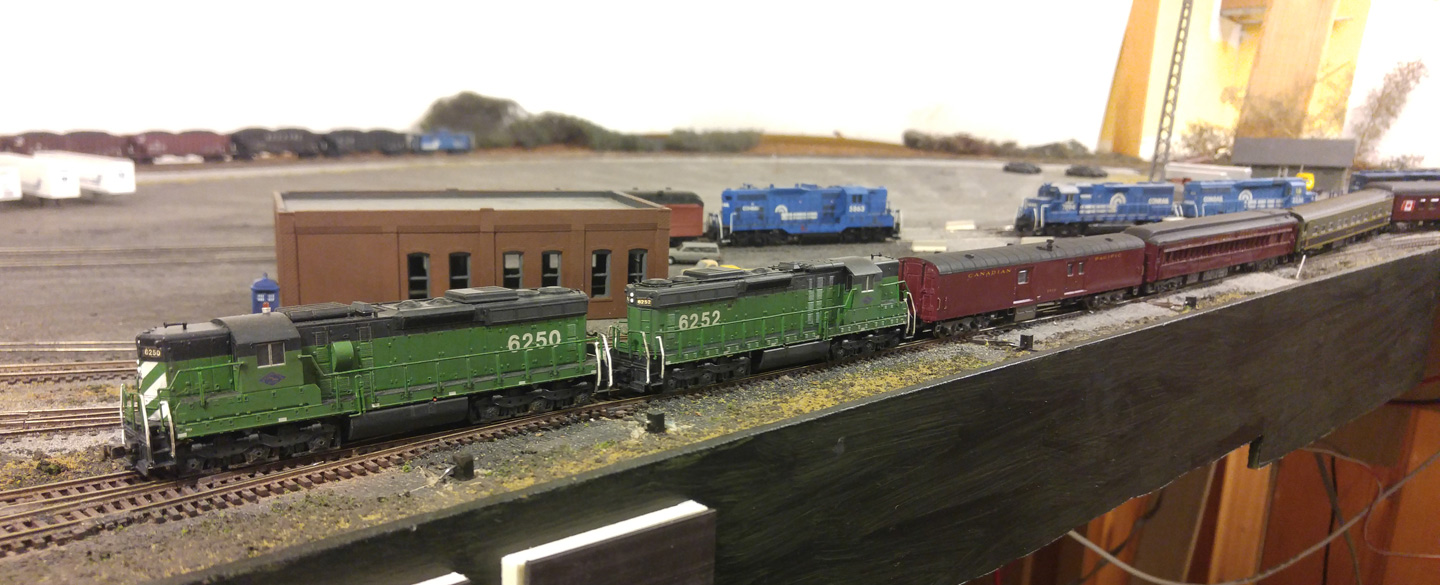 The MMID's SD24s pull the memorial train past the yard office and into Windsor St Yard.