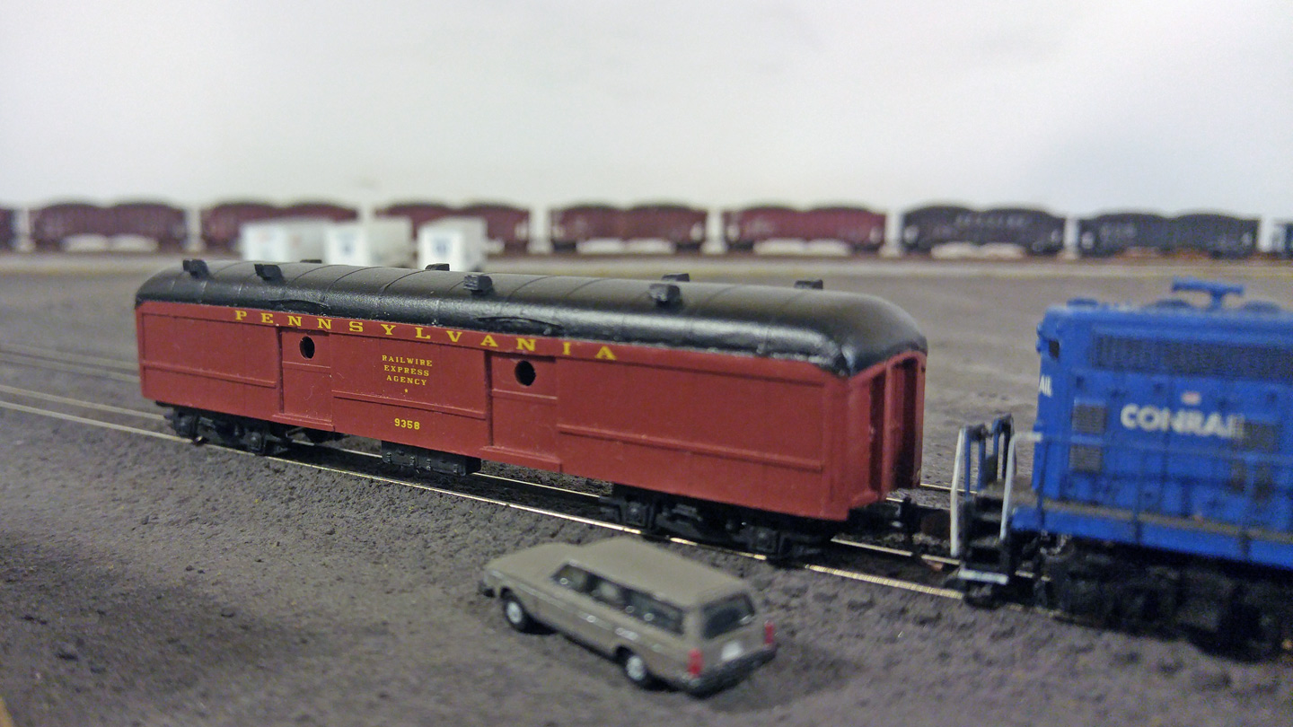 The Railwire Express Agency car arrived a few days ahead of time and has been sitting under guard on the pit track outside the yard office.