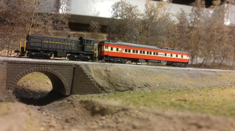 This time, the Baconrail car is being hauled by some new PRR power.